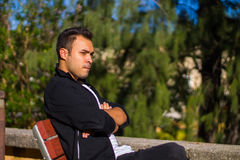 Man on a park bench Stock Photo