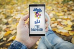 Man in the park free download smartphone. Man in the park with free download smartphone. All screen graphics are made up royalty free stock image