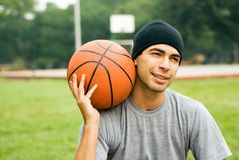 Man in Park Holding Basketball - Horizontal Stock Photos