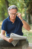 Man at park reading royalty free stock images