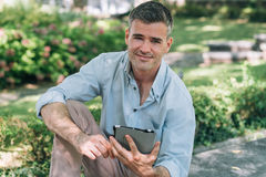 Man at the park using a tablet Stock Photography