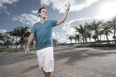Man in the park waving Stock Photography