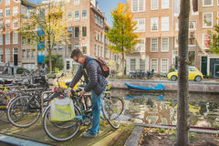 Man parking his bicycle Stock Images