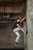 Man of parkour in urban space. Stock Photos