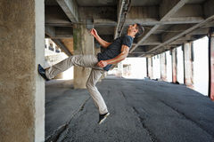 Man parkour in urban space. Stock Images