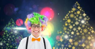 Man with party hair and Snowflake New Year Party lights colorful pattern shapes. Digital composite of Man with party hair and Snowflake New Year Party lights Royalty Free Stock Photos