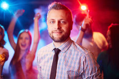 Man at party Stock Images
