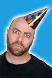 Man in party hat Stock Photo