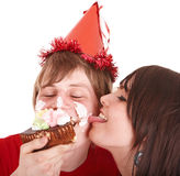 Man in party hat and girl eating cake. Royalty Free Stock Photos