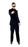 Man in party wear attire pointing at camera Royalty Free Stock Photography