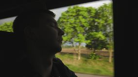 Man passenger asleep at the bus while traveling on the road stock footage