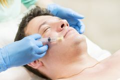Man passes a course of mesotherapy Royalty Free Stock Image