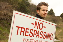 A Man Passing No Trespassing Sign Royalty Free Stock Photography