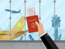 Man with passport and ticket inside of airport Stock Photo
