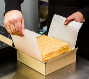 Man pastry cake napoleon packs in a box Royalty Free Stock Photography