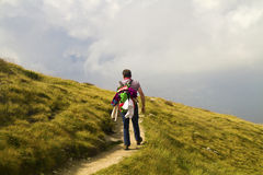 Man on the path. Man with a backpack on mountain trail Royalty Free Stock Images