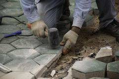 The man paving green concrete royalty free stock photography