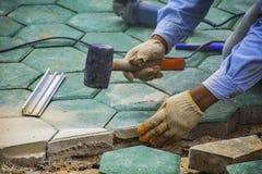 Workers is paving brick floors. stock photos