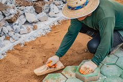 Workers is paving brick floors. stock photography