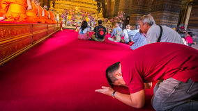 The man that pay homage to Buddha image and Monk . Royalty Free Stock Photography