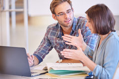Man paying attention to his female business counterpart while working Royalty Free Stock Photo