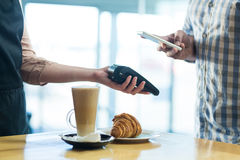 Man paying bill through smartphone using NFC technology royalty free stock images