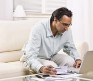 Free Man Paying Bills With Laptop Royalty Free Stock Photo - 10320745