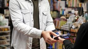 Man paying with contactless credit card stock footage