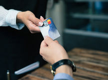 Man paying with credit card at the restaurant Stock Photo