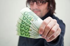 Man paying in euros Stock Photography