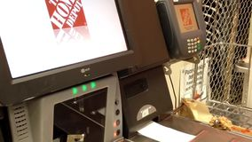 Man paying faucet connector and taking receipt at self checkout counter stock video footage