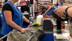 Man paying foods by credit card at checkout counter stock footage