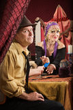 Man Paying Fortune Teller Stock Photography