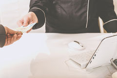 Man Paying for Groceries at Supermarket Checkout. Paying with Cash at Clothing Shop Counter. Customer Paying with Cash in the Apparel Shop. Woman Paying for Royalty Free Stock Photos