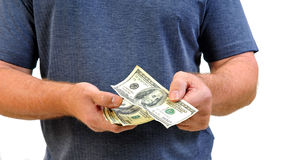 Man paying with hundred dollar bills Royalty Free Stock Images