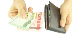 Man paying money and holding black pocket isolated Royalty Free Stock Photography