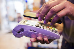 Man paying with NFC technology on mobile phone, in pharmacy Royalty Free Stock Photography