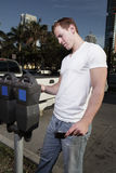 Man paying the parking meter Stock Photos