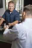 Man Paying For Repair Work Royalty Free Stock Image