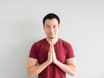 Man is paying respect. Asian man paying respect or begging for forgiveness Royalty Free Stock Images