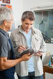 Man Paying Through Smartphone In Hardware Store Royalty Free Stock Images