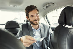Man paying the taxi with the cash Stock Images