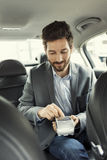 Man paying the taxi with the credit card Stock Image