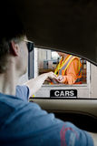 Man paying toll at toll booth Stock Images