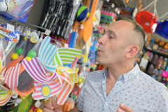 Man with paying in toy shop Royalty Free Stock Photo