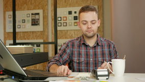 Man pays customer purchase cards in the office using the terminal. She holds and pulls out a card payment slip. stock video footage