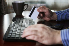 Man pays for online purchases with a credit card Royalty Free Stock Photos