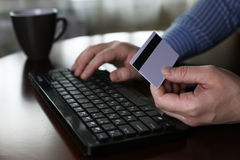 Man pays for online purchases with a credit card Stock Images
