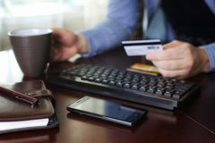 Man pays for online purchases with a credit card Stock Photo