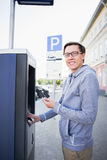 Man pays for parking stock photography